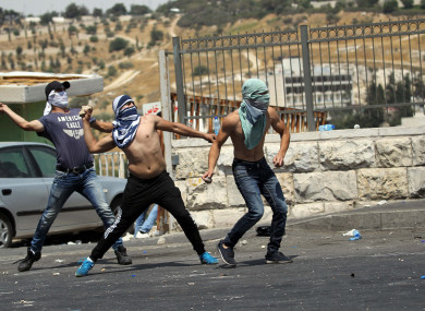 Palestinians clash with Israeli police in East Jerusalem.