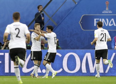 Germany's Lars Stindl, center right, celebrates after scoring.