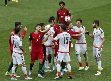 Portugal's and Mexico's players argue during the Confederations Cup, third place match.
