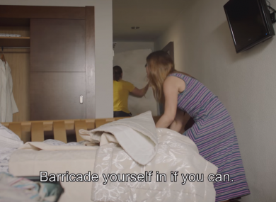 A screengrab from the video showing a family barricading themselves into their hotel room.