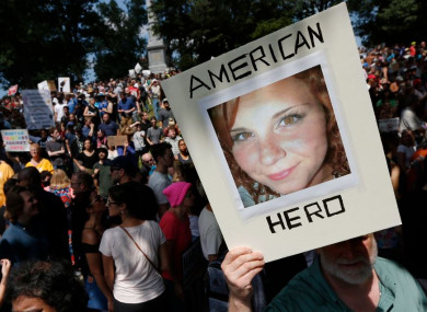 A demonstrator holds a photo of Heather Heyer, who was killed in Charlottesville, at a rally in Boston last weekend