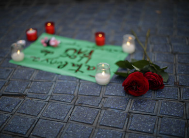 Flowers and candles placed on the pavement at Las Ramblas