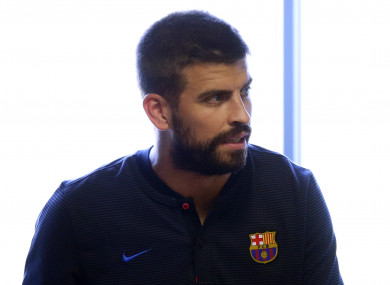 FC Barcelona's Gerard Pique arrives for a press conference.