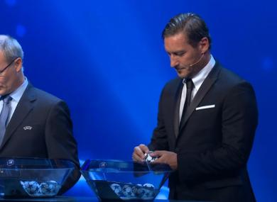 Italian legend Francesco Totti taking part in the draw with Uefa competitions director Giorgio Marchetti.
