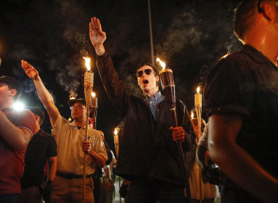 Multiple white nationalist groups march with torches through the UVA campus in Charlottesville.
