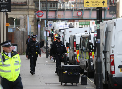 Police activity outside Parsons Green station in west London yesterday.