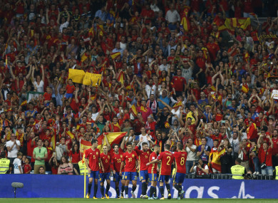 Spain's Isco, centre, celebrates with team mates after scoring his side's second goal.