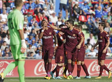 Barcelona's Paulinho, left, celebrates with teammate Luis Suarez after scoring against Getafe.