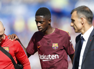 Dembele limped off during Barcelona's 2-1 win against Getafe.