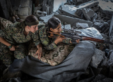 Soldiers of the Women's Protection Units (YPJ) targeting IS fighters in Raqa.