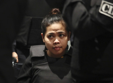 Vietnamese Doan Thi Huong is escorted by police at Kuala Lumpur International Airport in Sepang, Malaysia