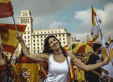 Anti-separatist Catalans shout slogans as they gather at Barcelona's Placa de Catalunya.