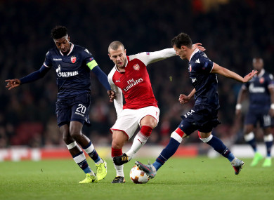 Arsenal's Jack Wilshere (right) with Red Star Belgrade's Mitchell Donald (left) and Slavoljub Srnic.
