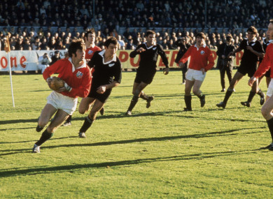 Barry John of the British Lions is pursued by Tane Norton of New Zealand in 1971.