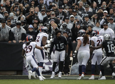 Michael Crabtree was ejected after attempting to fight the entire Denver Broncos roster.