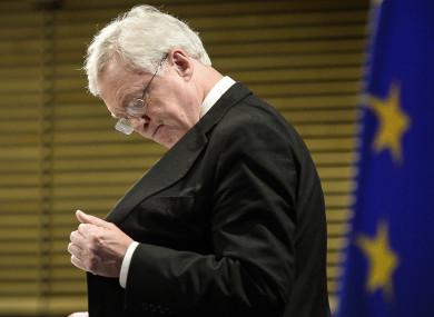 The UK's Secretary of State for Exiting the EU, David Davis reaches inside his inside pocket.