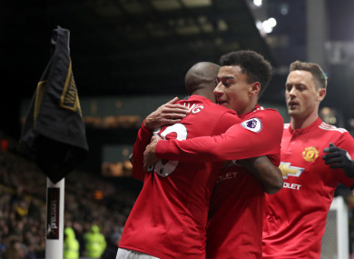 Manchester United's Ashley Young (left) celebrates scoring his side's first goal.