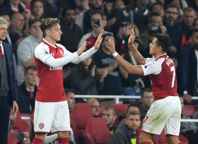 Arsenal manager Arsene Wenger with Mesut Ozil and Alexis Sanchez