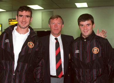 Eric Cantona (left) and Roy Keane (right) pose with Alex Ferguson.