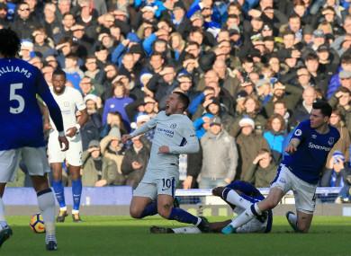 Chelsea's Eden Hazard (centre) reacts after a tackle during the Premier League match at Goodison Park.