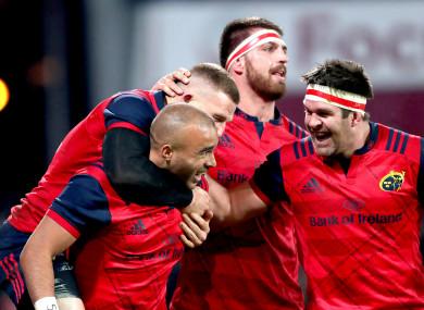 Munster celebrate Zebo's try.