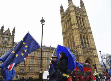Demonstrators gathered to protest against Brexit, outside the Parliament with EU and Union flag yesterday.