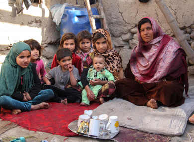 File photo of a widow sitting next to her daughters in her mud-walled house in the women's village of Sanabad, southwest of Kabul, Afghanistan.