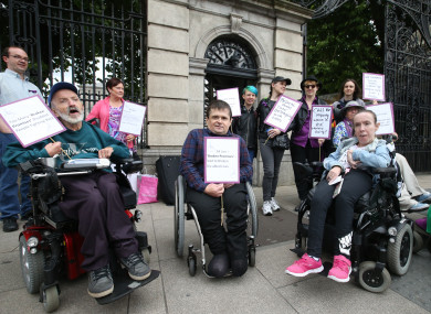 Protesters outside Leinster House last year who claim the government has broken its promises to disabled people by not ratifying the UN Convention on Rights for Disabled people.