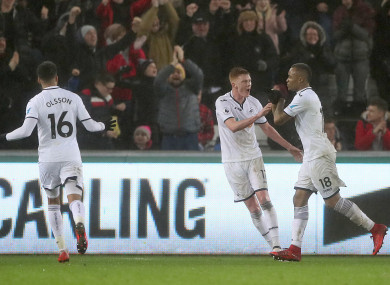 Swansea goalscorer Jordan Ayew (right) with Sam Clucas (centre) and Martin Olsson.