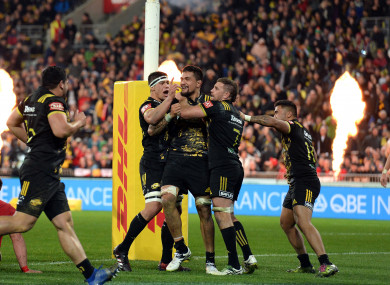 Hurricanes celebrate Vaea Fifita's try against the Lions.