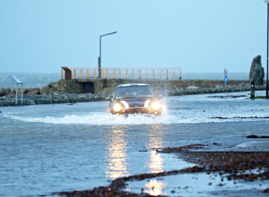 A car drives through a flooded car park in Salthill, Galway.