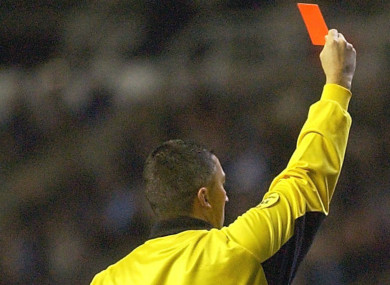 A referee shows a red card