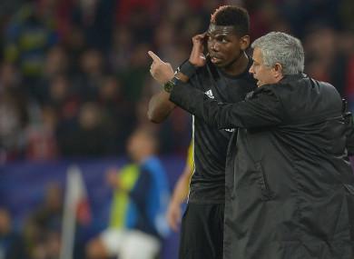 Manchester United midfielder Paul Pogba and Jose Mourinho.