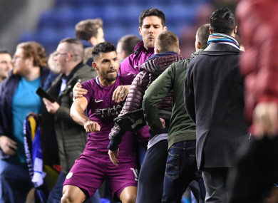 Sergio Aguero is surrounded by fans after Wigan Athletic beat Manchester City.