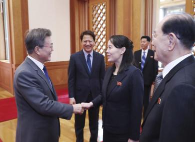 South Korean President Moon Jae-in, left, shakes hands with Kim Yo Jong, North Korea leader Kim Jong Un's sister