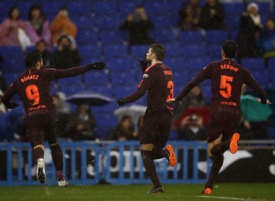 FC Barcelona's Gerard Pique, centre, celebrates after scoring.