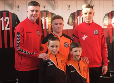 Steven Nolan, Jamie Hamilton and Darragh Leahy with St Kevin's Boys youngsters Michael and Zach.