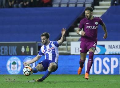 Grigg struck in the second half to send Wigan through.