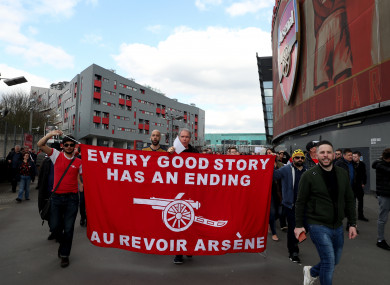 Fans with a banner outside the Emirates Stadium (file photo).
