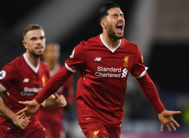 Emre Can celebrates a Liverpool goal.