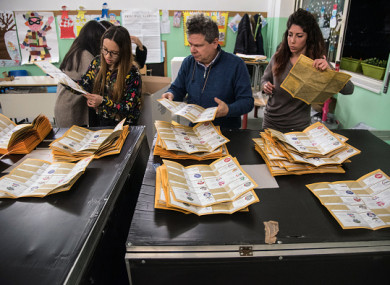 Paper ballots are counted after the end of voting in the Italian general elections.