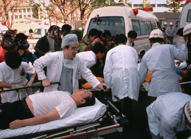 In this March 20, 1995 file photo, subway passengers affected by sarin gas planted in the central Tokyo subways are carried into St. Luke's International Hospital in Tokyo.