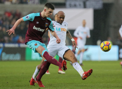 Rice in action for West Ham against Swansea's Andre Ayew.