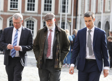 Brian Purcell (middle) on his way into Dublin Castle