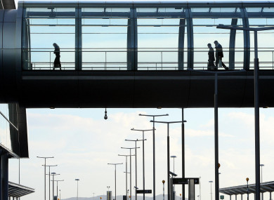 A stock photo of members of the public walking through Dublin Airport's Terminal 2.