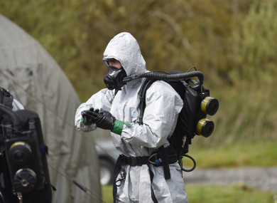 An EOD technician preps prior to entering the aircraft fuselage to inspect the scene. Rigorous checks are carried out to ensure the suit is adequately sealed.