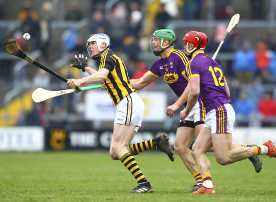 Kilkenny's TJ Reid gets away from two Wexford players.