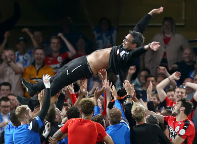Huddersfield Town manager David Wagner is thrown into the air by the players as they celebrate Premier League safefy.