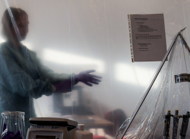 File Photo: Tropical Medicine worker prepares for work inside mobile laboratories unit (EMLab)