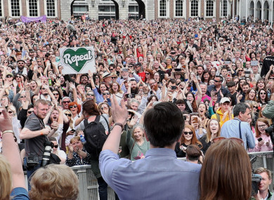 Simon Harris and Leo Varadkar on stage at Dublin Castle yesterday.